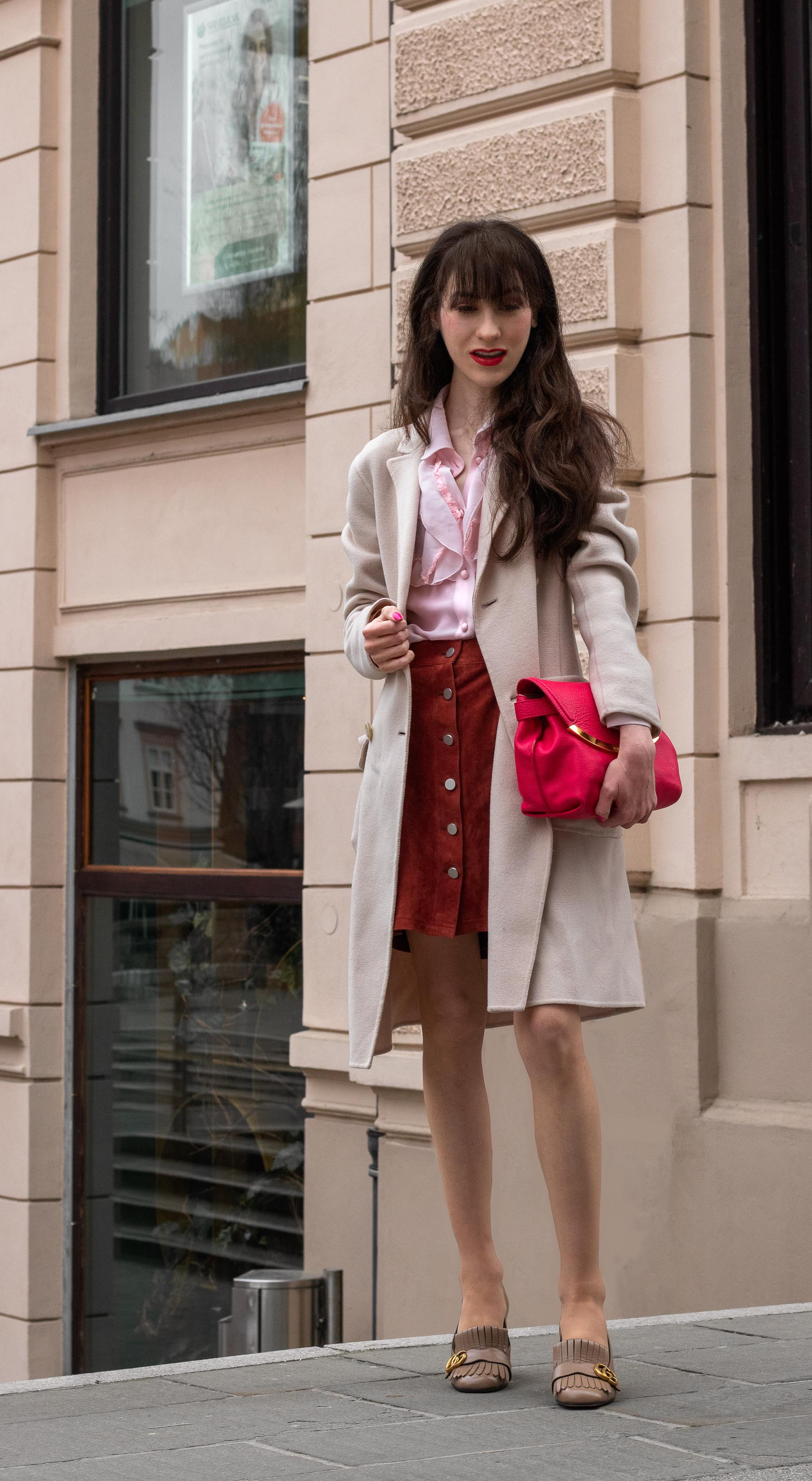 Fashion blogger Veronika Lipar of Brunette from Wall Street wearing Weekend Max Mara double breasted coat Red Valentino pink blouse brown suede front button short skirt pink pouch bag Gucci heeled loafers Sunday to Monday