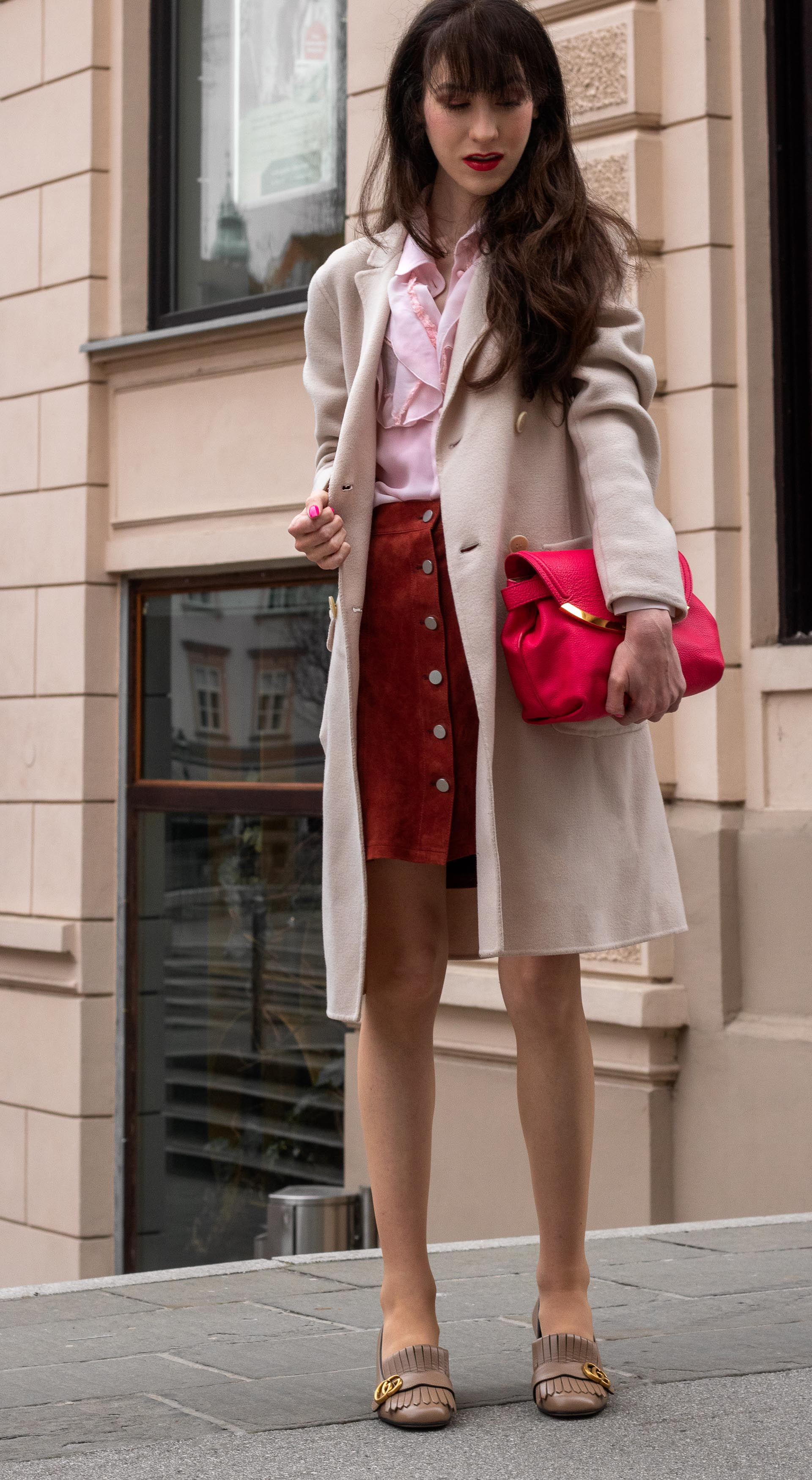 Fashion blogger Veronika Lipar of Brunette from Wall Street dressed in easy transitional outfit Weekend Max Mara double breasted coat Red Valentino pink blouse brown suede front button short skirt pink pouch bag Gucci heeled loafers Monday to Sunday