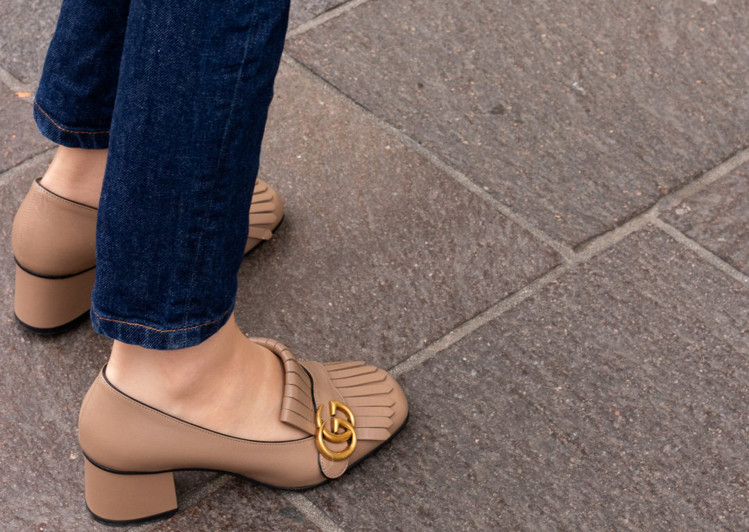 Fashion blogger Veronika Lipar of Brunette from Wall Street wearing simple transitional outfit Gucci heeled loafer A.P.C. navy blue jeans
