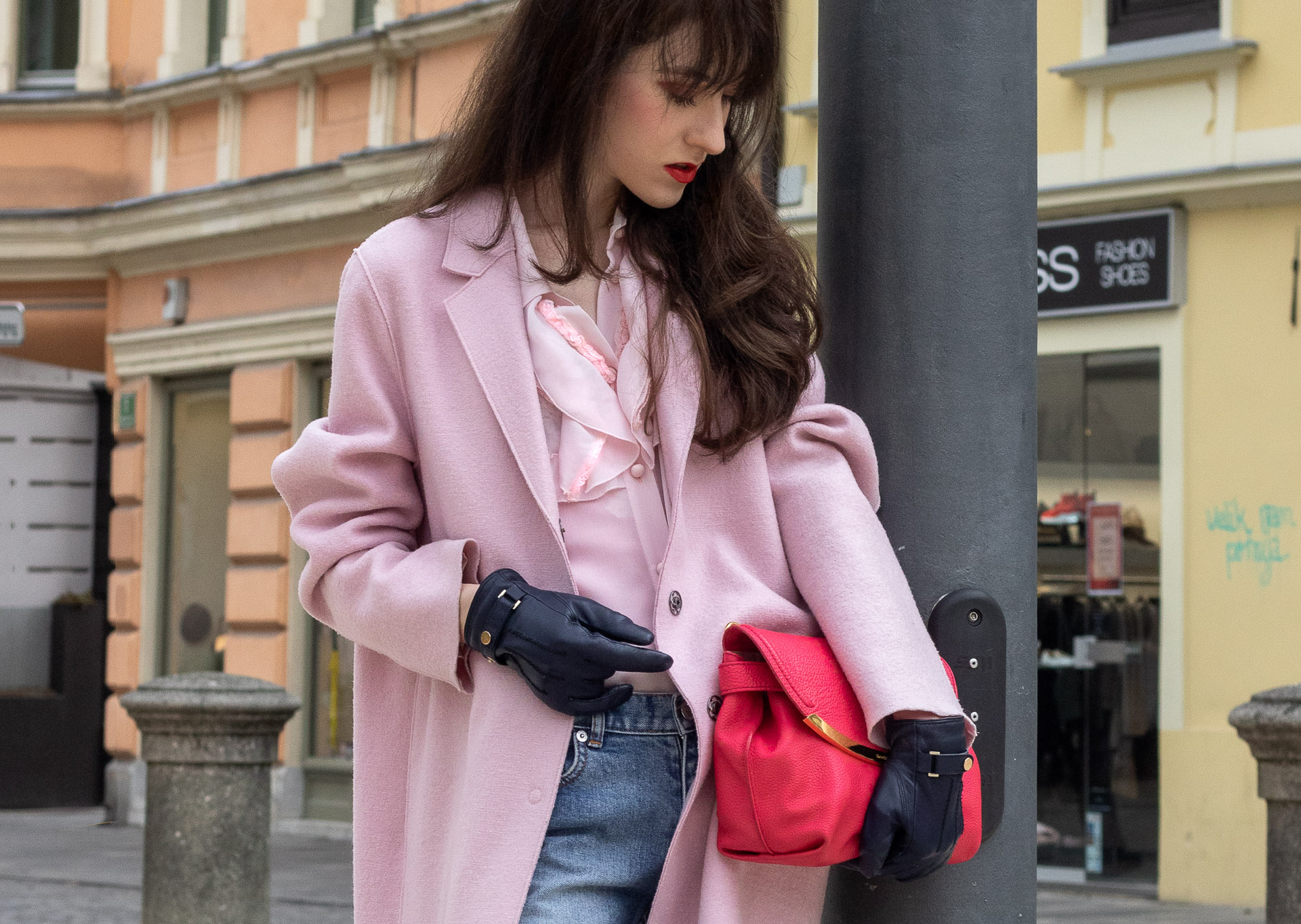 Fashion blogger Veronika Lipar of Brunette from Wall Street wearing A.P.C. blue jeans Harris Wharf London pink coat Red Valentino pink blouse pink pouch bag leather gloves
