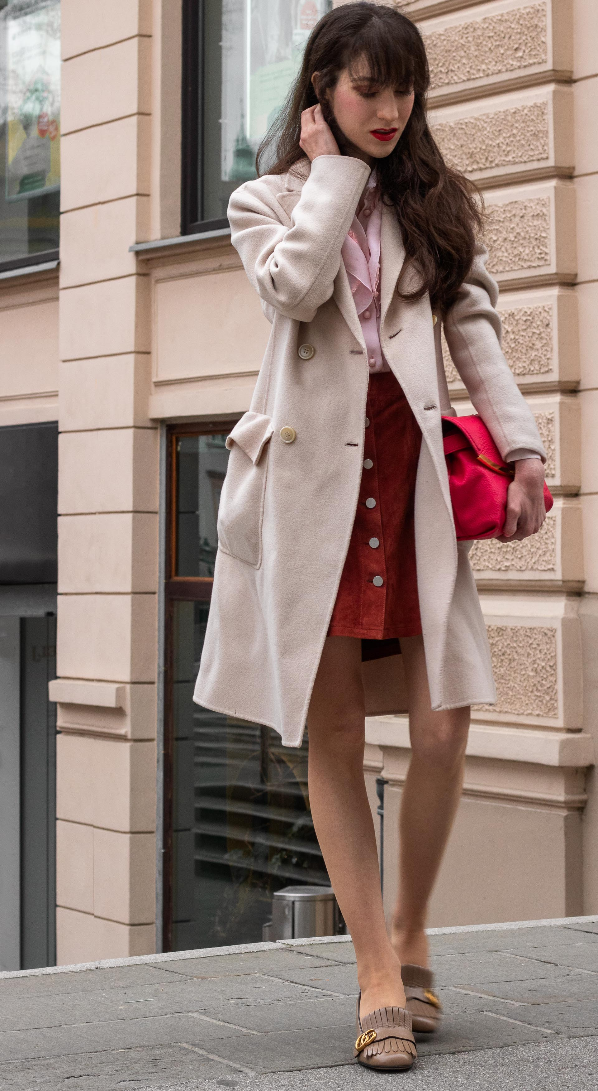 Fashion blogger Veronika Lipar of Brunette from Wall Street dressed in fancy transitional outfit Weekend Max Mara double breasted coat Red Valentino pink blouse brown suede front button short skirt pink pouch bag Gucci heeled loafers