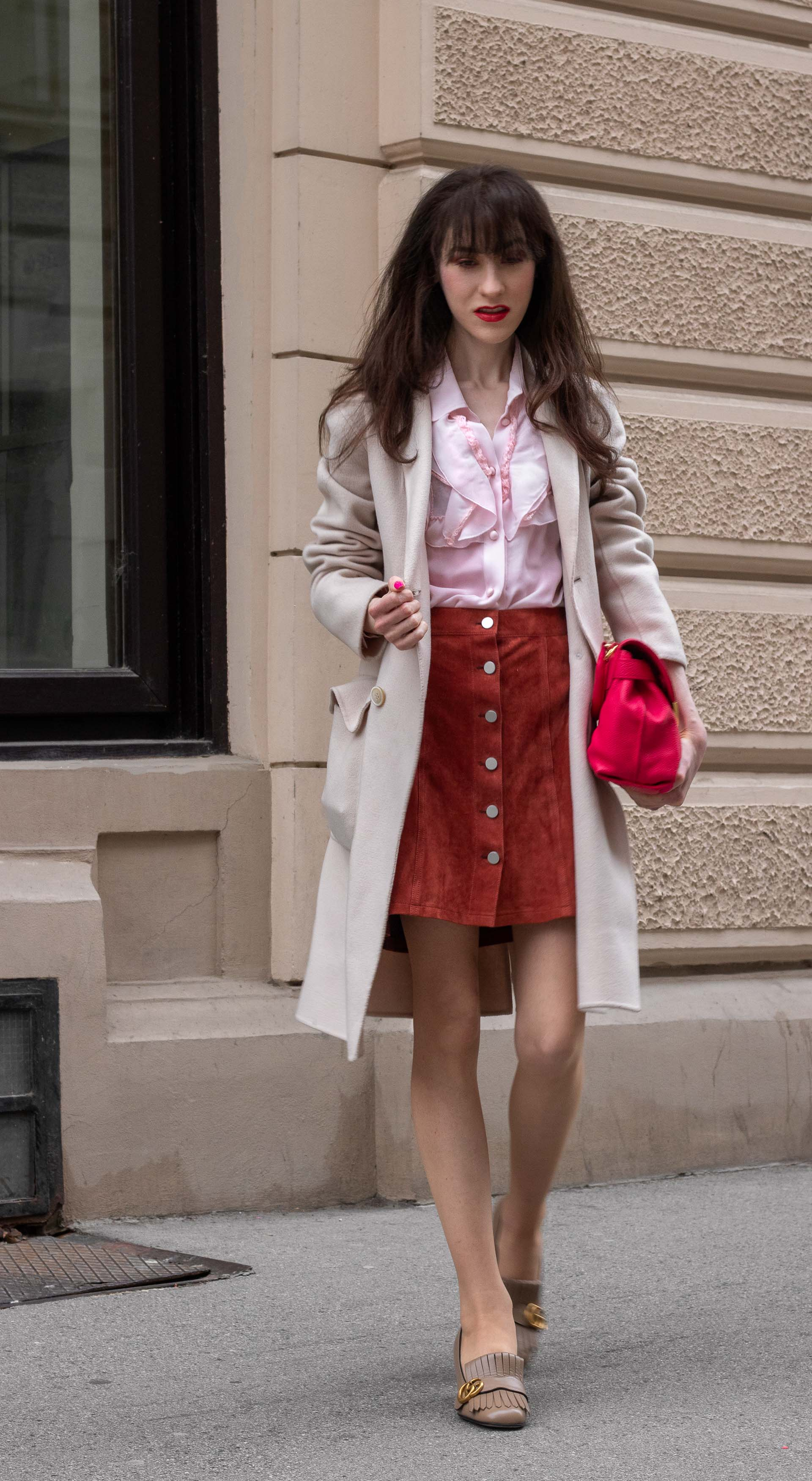 Fashion blogger Veronika Lipar of Brunette from Wall Street wearing easy transitional outfit Weekend Max Mara double breasted coat Red Valentino pink blouse brown suede front button short skirt pink pouch bag Gucci heeled loafers Sunday to Monday