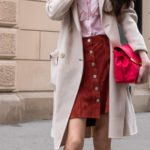 Fashion blogger Veronika Lipar of Brunette from Wall Street wearing Weekend Max Mara double breasted coat Red Valentino pink blouse brown suede front button short skirt pink pouch bag in March on street