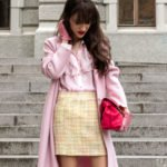 Fashion blogger Veronika Lipar of Brunette from Wall Street wearing pink Harris Wharf London coat pink Red Valentino Victorian blouse yellow tweed mini skirt for Sunday brunch in early spring