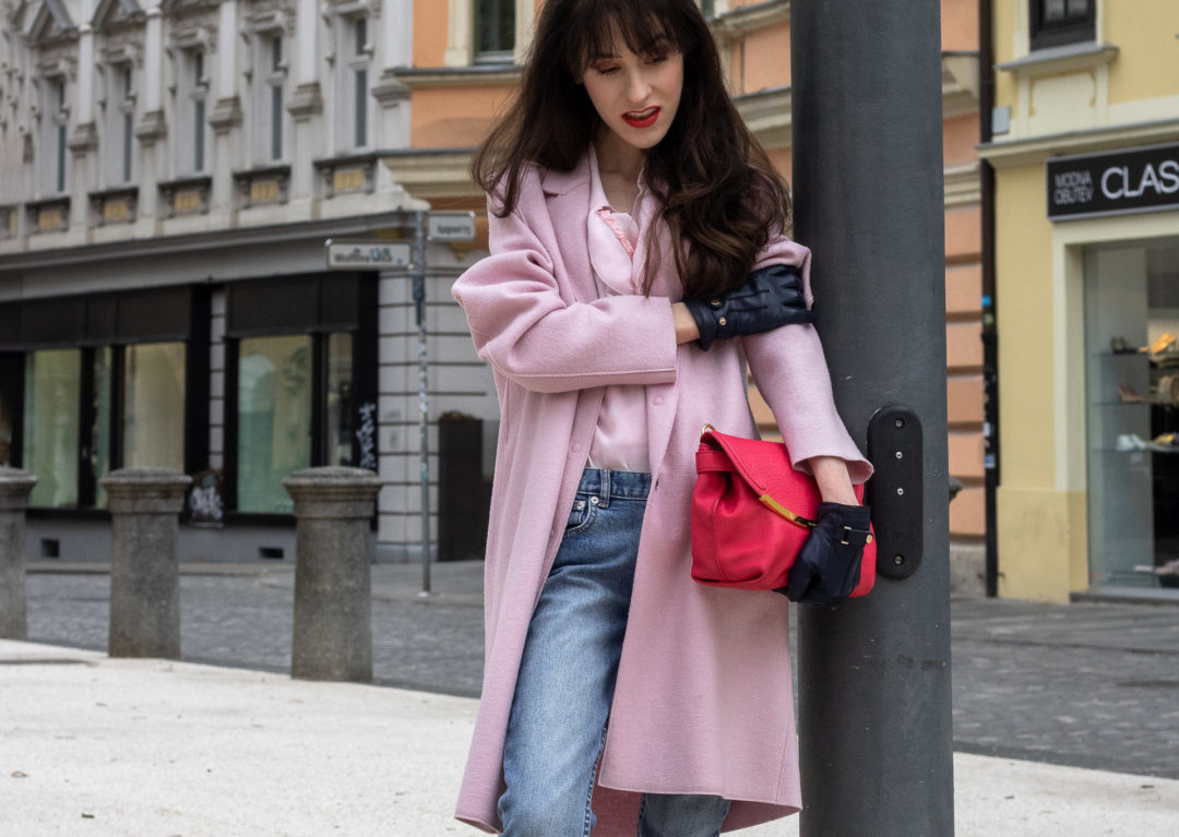 Fashion blogger Veronika Lipar of Brunette from Wall Street dressed in A.P.C. blue jeans Harris Wharf London pink coat Red Valentino pink blouse pink pouch bag leather gloves in between seasons