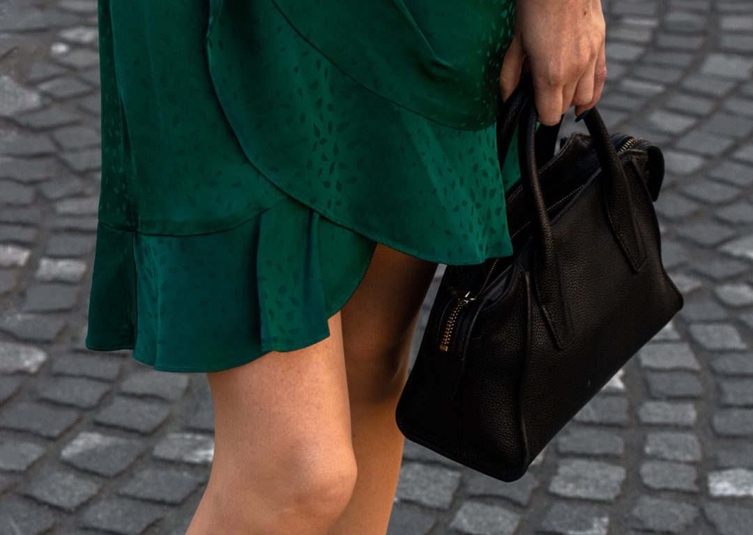 Brunette from Wall Street Self-Portrait emerlad wrap ruffle hem dress black bag how to style wrap dress when going out