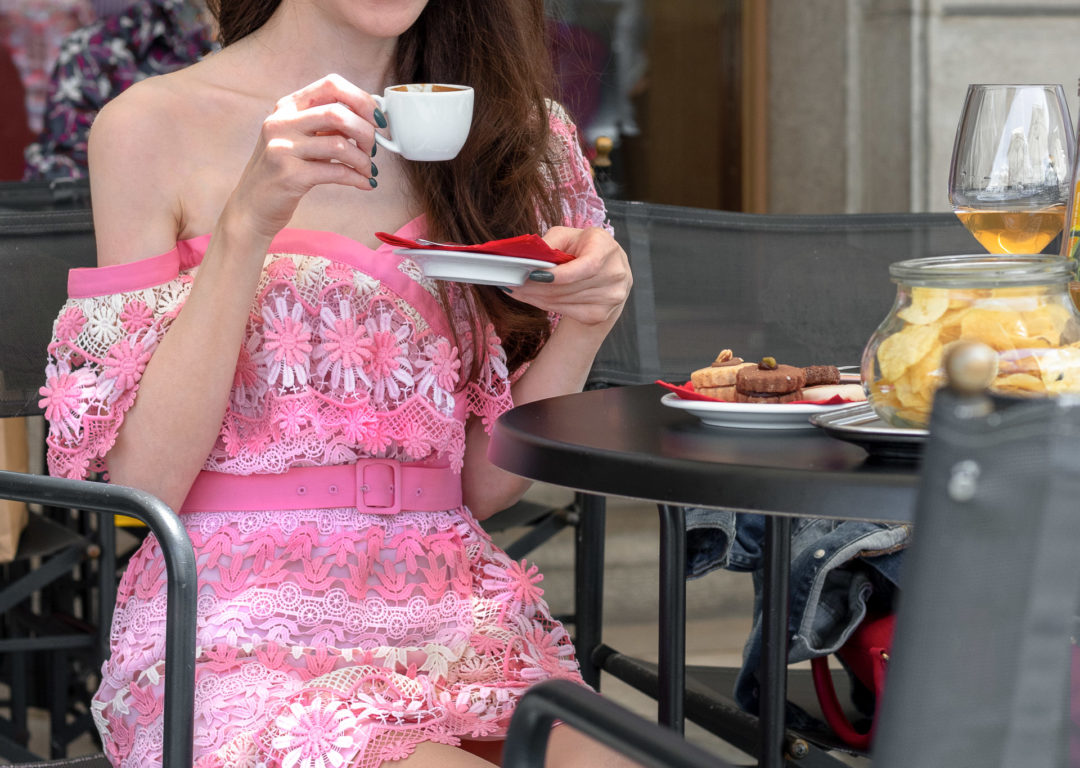 Fashion blogger Veronika Lipar of Brunette from Wall Street wearing Self-Portrait pink off the shoulder dress for a summer coffee date