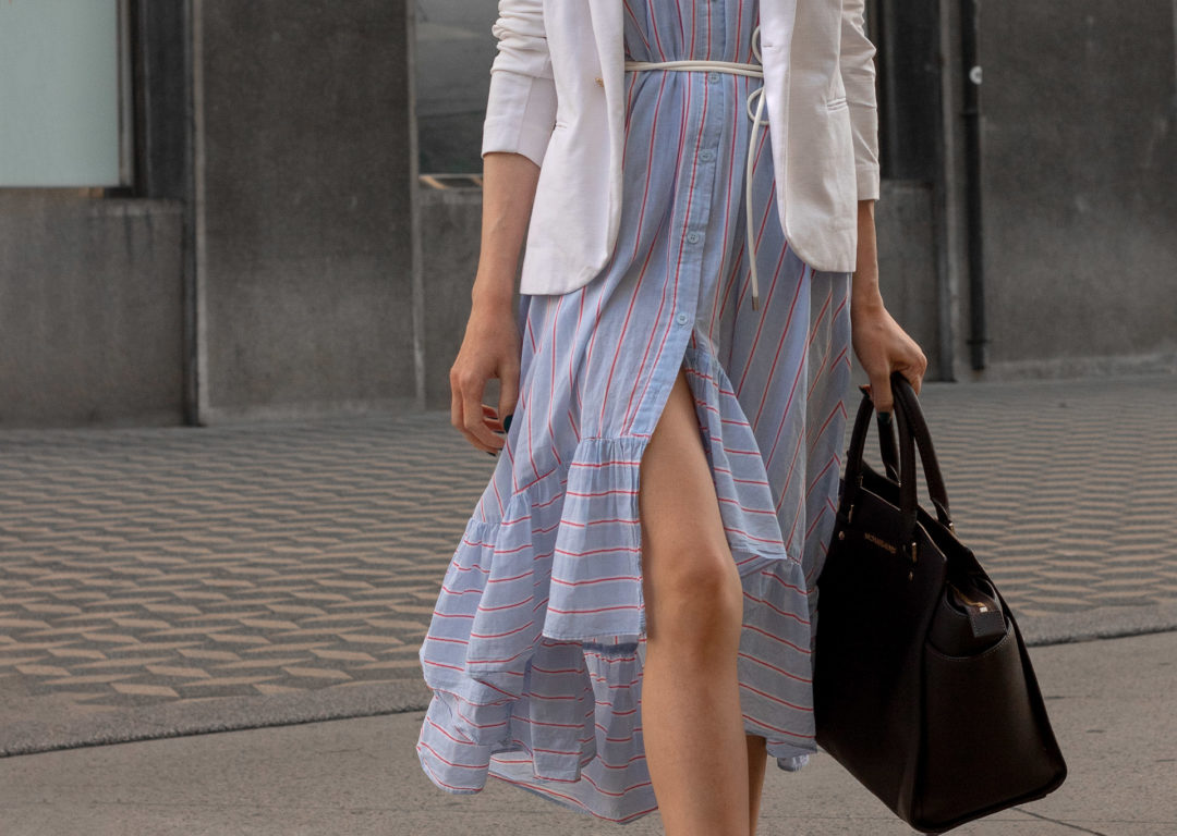 Fashion blogger Veronika Lipar of Brunette from Wall Street always fashionable white blazer over shirt dress with business bag for work in summer