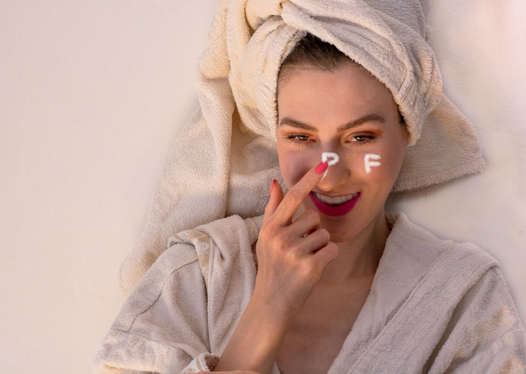 Fashion blogger Veronika Lipar of Brunette from Wall Street applying spf cream on face