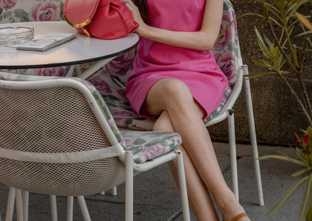Fashion blogger Veronika Lipar of Brunette from Wall Street wearing simple summer outfit pink cocktail dress By Far sandals pink top handle bag for brunch