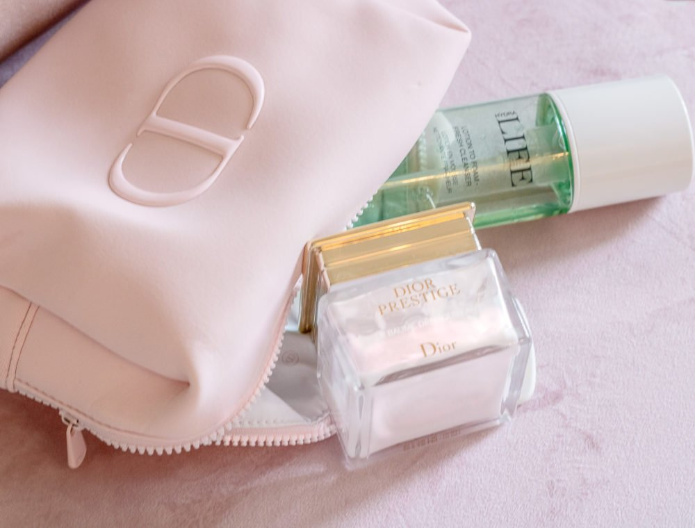 Brunette from Wall Street capsule beauty bag beauty products for essential skincare routine DIOR Prestige cleansing balm Dior foam to lotion cleanser Dior cosmetic bag
